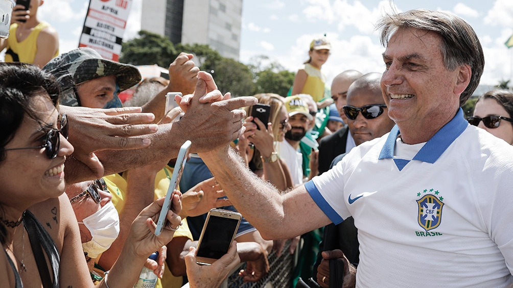 """Bolsonaro se burló del """"toque de queda"""" en Argentina y Alberto lo trató de """"ignorante"""""""